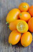 stock photo of kumquat  - kumquat fruit on wooden table - JPG