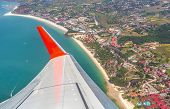 stock photo of langkawi  - Wing of the plane above Langkawi Island Malaysia - JPG