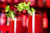stock photo of bloody  - Bloody Mary cocktail shot on a bar counter - JPG