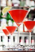 image of cosmopolitan  - Four Cosmopolitan cocktails shot on a bar counter in a night club - JPG