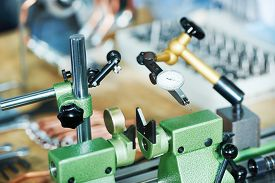 stock photo of micrometer  - Measuring equipment micrometer at manufacturing industry factory - JPG