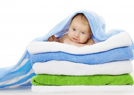 stock photo of infant  - Baby Under Towels Blanket Clean Kid after Bath Cute Infant Isolated over White Background - JPG