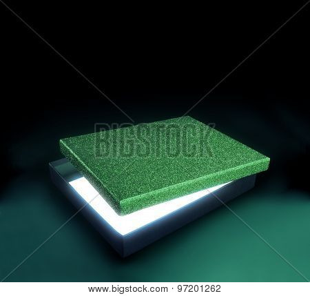 Green Color Gift Box. Opened Box Against Black Background With Copy Space. Light Effect Inside.