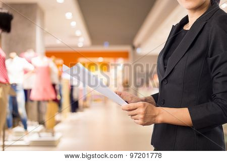 Businesswoman Reading A Business Document.