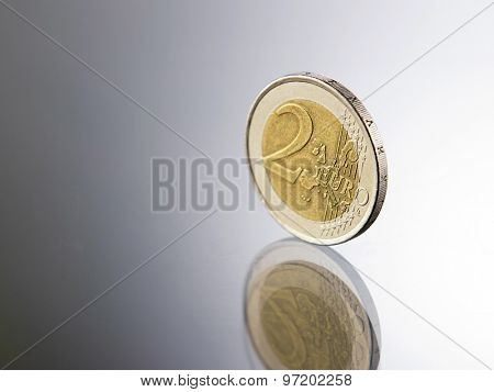 two euro coin on the glass top