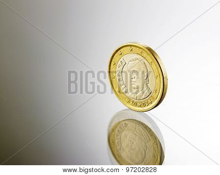 euro coin on top of glass
