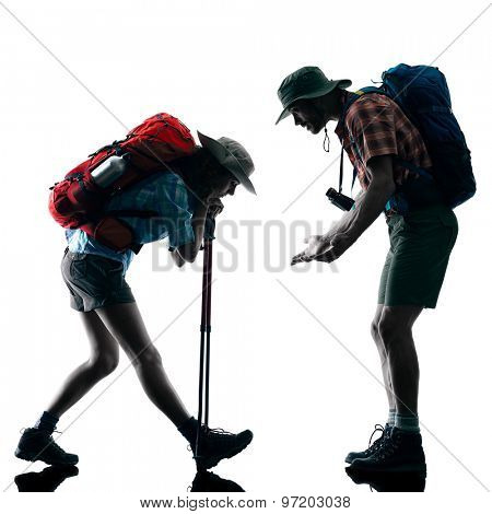 one caucasian couple trekker trekking tired in silhouette isolated on white background
