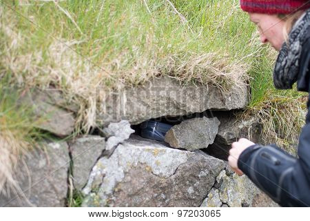Woman Finding A Geocache