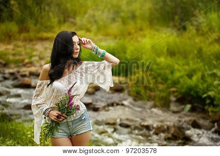 Boho Girl Holding Bouquet Of Wildflowers.