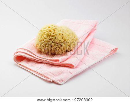 natural sponge on the pink towel