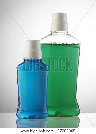 two bottles of the mouth wash without label