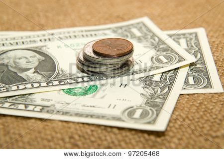 Us Dollars Banknotes And Coins On An Old Cloth