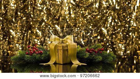 Gold Present And Christmas Tree Branches