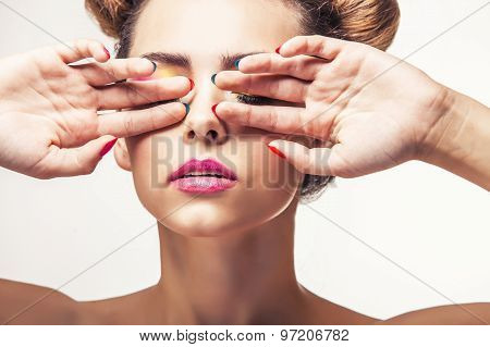 Model, A Woman With Bright Makeup And Bright Nail Polish On A White Background