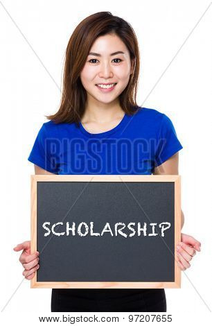 Asian woman hold with chalkboard and showing a word scholarship