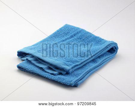 Folded towel isolated on white background