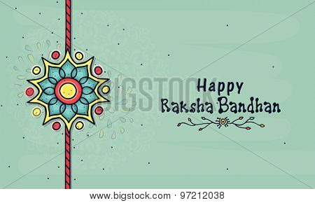 Beautiful creative rakhi on floral design decorated background for Indian festival, Raksha Bandhan celebration.