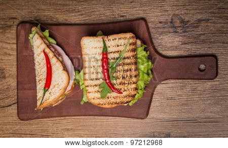 Classic Club Sandwich With Bacon And Vegetables
