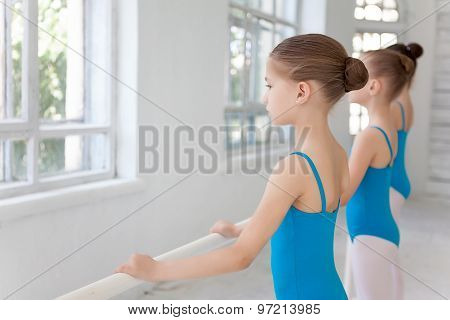Three little ballet girls posing together