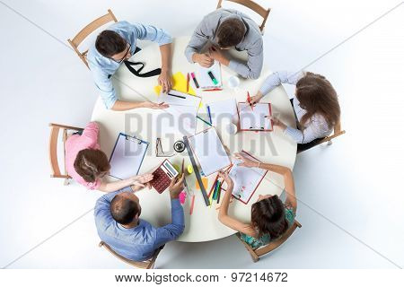 Top view of business team on workspace background