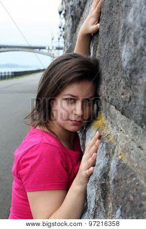 Woman Near Stone Wall