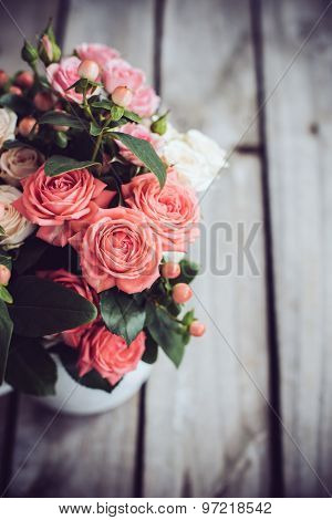 Bouquet of roses in vintage coffee pot