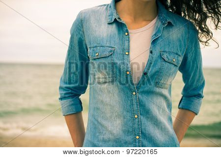 Denim Shirt On A Girl With Curly Hair Close-up On A Background Of The Sea