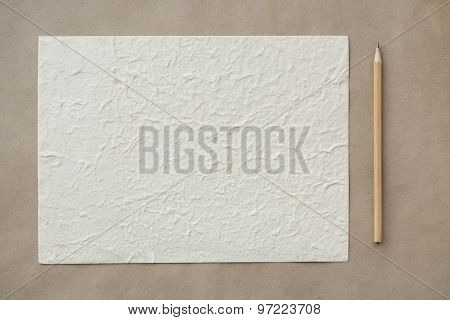 Sheet and pencil