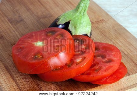 Freshly Slised Egg-plant And Tomato On A Cutting Board