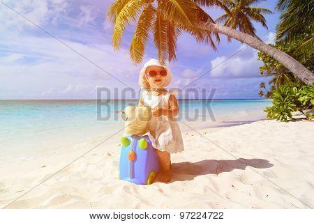 cute little girl travel on summer beach
