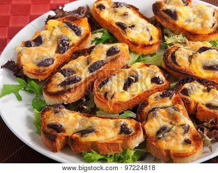 Bruschetta With Olives And Mozzarella