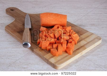 Chopped Carrot On A Wooden Cutting Board