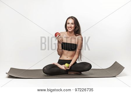 Very Attractive Young Woman Sitting On Yoga Mat