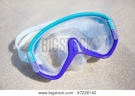 Blue Diving Mask On Sandy Beach