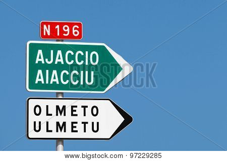 Road Sign. White And Green Arrows With Destination