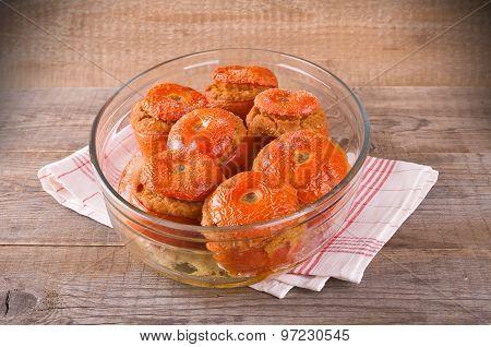 Stuffed tomatoes on glass bowl.