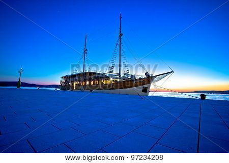 Old Wooden Sailboat At Blue Evening