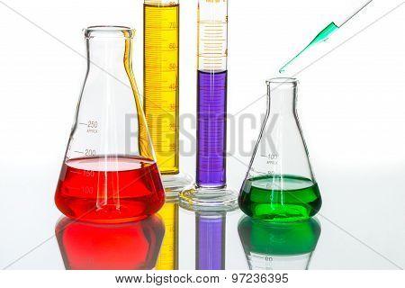 Science Laboratory Glassware Pipette Drop, Reflective White Background