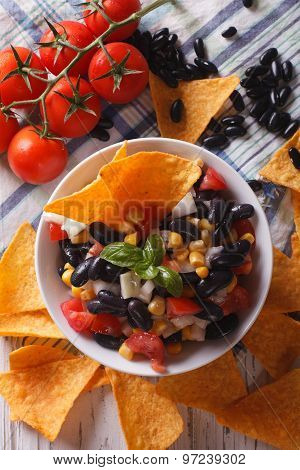 Mexican Salsa And Corn Chips Nachos Close-up. Vertical Top View