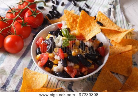 Mexican Cuisine: Tasty Salsa And Corn Chips Nachos Close-up. Horizontal