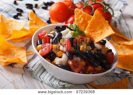Mexican Food: Salsa With Black Beans And Nachos Closeup. Horizontal
