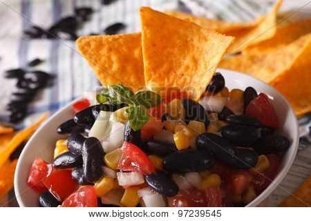 Mexican Salsa With Black Beans And Corn Chips Nachos Macro. Horizontal