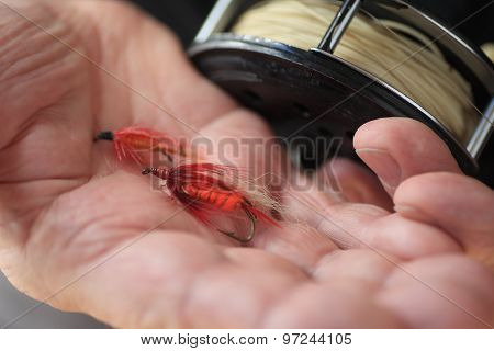 Man Holds Artificial Fishing flies