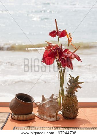 Pineapple, Shell, Flowers On A Beach Table