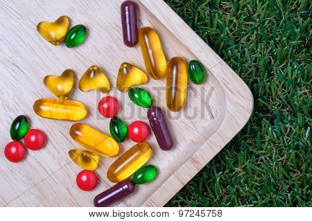 Medicine And Vitamin On Wooden Plate