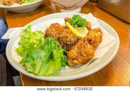 Fried Chicken On A White Plate