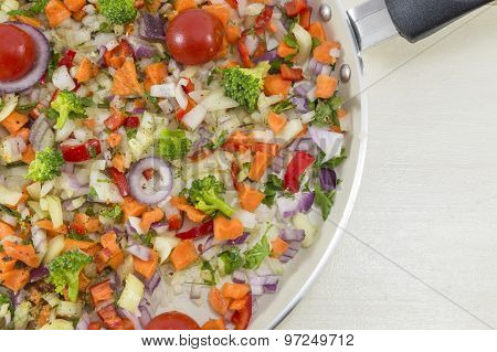 Vegetable Salad On A Pan Ready To Be Cooked For A Healthy Meal