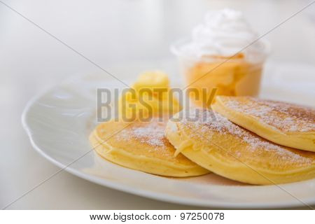Pan cake with ice cream on table