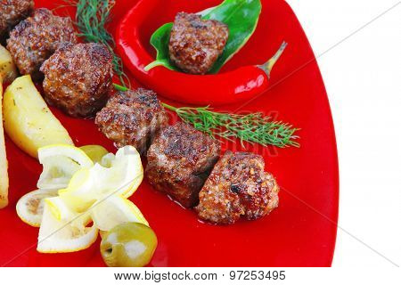 grilled beef meatballs with gold baked potatoes
