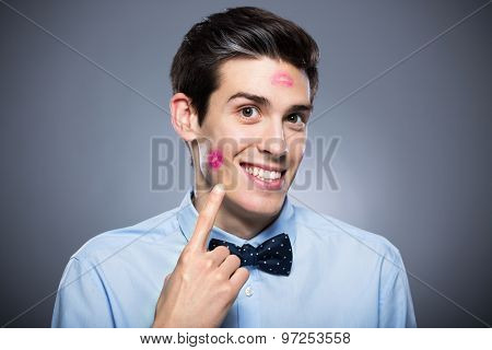 Man with lipstick marks